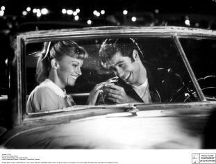 GR4122_BW-Sandy-Zuko-at-Drive-Thru-laughing_Grease_1978_209_PF.jpg