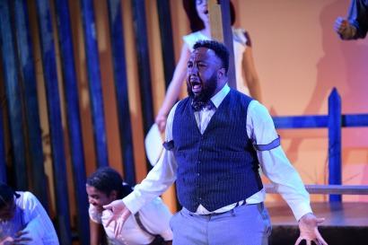 Derrick L. Millard II as Preacher. Photo by Alex Medvick